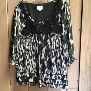 ECI top with black applicated  flowers on neckline
